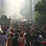 Pakistani airliner carrying 99 plunges into Karachi houses