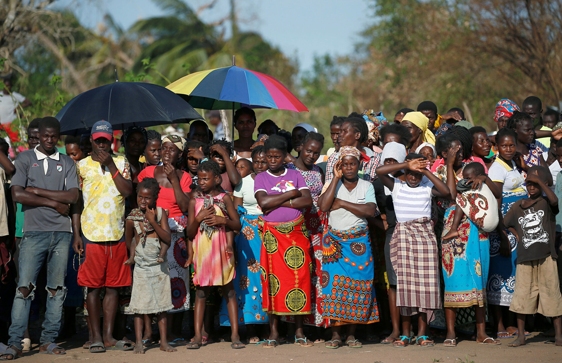 People wait for food aid in the aftermath of Cyclone Idai