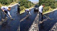 Eriyen asfalta yapışan yılanı vatandaş kurtardı