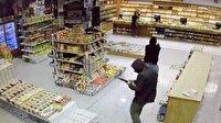 Film sahnelerini aratmayan silahlı soygun kamerada