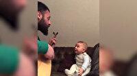 Babasından 'Bil oğlum' türküsünü hayranlıkla dinleyen bebek