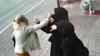 Çarşaflı kadınlara çirkin saldırı kamerada