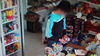 Markette telefon hırsızlığı kamerada
