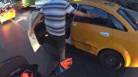 Minibüsçü küfür ettiğini düşündüğü taksiciyi tekmeledi