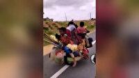 7 kişi 2 köpek ve eşyaları bir motosikletle taşıdı