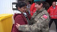 Depremzede kadın, yardım dağıtan Türk subayına sarılıp ağladı