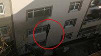 Hamile kadın yangından komşularının sarkıttığı iple kurtuldu