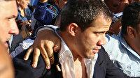 """Darbeci Guaido'ya havaalanında """"sıcak"""" karşılama: Üzerine su atıp saldırdılar"""