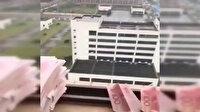 Umutsuz Vuhanlılar paralarını uçak yapıp camdan uçuruyor