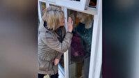 İngiltere'de bir sunucu, annesiyle pencere arkasından hasret giderdi