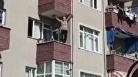 Balkonun kenarına çıkarak dans eden kişi görenleri şaşırttı