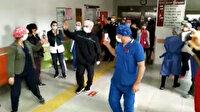 Salgınla mücadele için hastaneye dönüp koronavirüse yakalanmıştı: Emekli doktor 24 gün sonra alkışlarla taburcu oldu