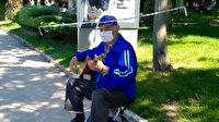 Sosyal mesafeli şapkasıyla sokağa çıkanlar için şarkı söyledi