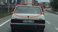 Otoyolda ilginç görüntü: Arabanın arka koltuğunda inek taşıdı