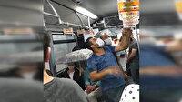 Metrobüste tavandan akan sudan dolayı şemsiyeyle yolculuk ettiler