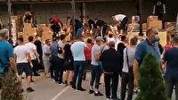 Sancaklılar Türkiye'den gelen malzemeleri taşımak için hastaneye koştular
