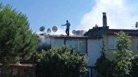 Çatıya çıkıp bahçe hortumuyla yangına müdahale etti: Elleri yanan vatandaşı itfaiye ekipleri kurtardı