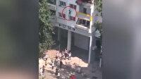 Fransa'da iki çocuk, yanan binanın camından atladı