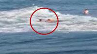 Serinlemek için denize giren fındık işçisini, tatilciler son anda boğulmaktan kurtardı