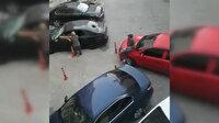 Kavgalı oldukları ailenin arabasını parçaladılar