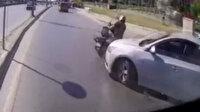Halk otobüsünün kaza yapan motosiklet sürücüsünü ezmemek için refüje çıktığı anlar kamerada