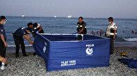 Antalya'da şaşkına çeviren olay: Ceset kıyıya çıkarıldı tatilciler denize girmeye devam etti  