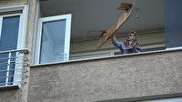 Sinir krizi geçirdi, eşyalarını balkondan sokağa fırlattı