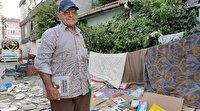 Rutubetten korumak için yüzlerce kitabını sokağa serip kurutma bıraktı: Yetkililerden çürümemeleri için yer istiyor
