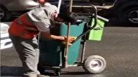 El arabasını temizlerken görüntülenen temizlik işçisi sosyal medyada büyük ilgi gördü