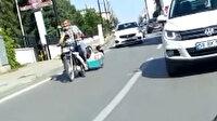 Sivas'ta motosikletin arakasına bağladığı sepetle çocuk gezdirdi