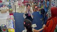 Alışveriş yapmak için gittiği mağazada beğendiği avize kafasına düştü