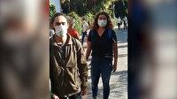İzmir'de AK Parti standını basan zorbaları genç kız 'Erdoğan' sloganı atarak püskürttü