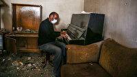 Ermenistan'ın katliam yaptığı Gence'de yıkılan evinde piyanosunu çaldı