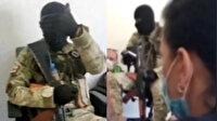Gürcistan'da rehine krizi: Silahlı soyguncu bankada 20 kişiyi rehin aldı