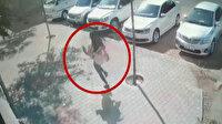 Kapkaça uğrayan kadının hırsızı kovaladığı anlar kamerada