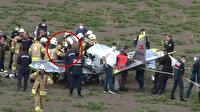 Büyükçekmece'de eğitim uçağı düştü: Yaralanan 1 kişinin uçaktan çıkarılma anı kamerada