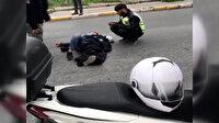 Polisten yürek ısıtan davranış: Kaza yapan kişinin üzerine montunu örttü