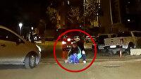 Otomobilin açılan kapısından düşen üç yaşındaki çocuk kameraya yansıdı