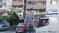 Sepetli araçla İzmir'deki Yılmaz Erbek Apartmanı'nın kahramanı oldular