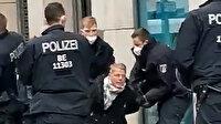 Alman polisi protesto gösterilerine katılan milletvekiline ters kelepçe taktı