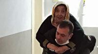 Polisten gönülleri fetheden hareket: Yaşlı kadını beşinci kata kadar sırtında taşıdı