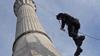 Köy imamı caminin 40 metre yüksekliğindeki minaresini boyayabilmek için dağcılık eğitimi aldı