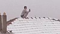 Esenler'de akılalmaz görüntü: Kar fotoğrafı çekmek için çatıya çıktı