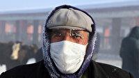 Termometrelerin -28 dereceyi gösterdiği Ağrı'da vatandaşların kaşları kırağı tuttu