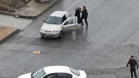 Başakşehir'de kadını zorla otomobile bindirmek isteyen kişiye çevredekiler engel oldu