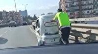 Trafik polisinden gönülleri fetheden davranış: Engelli vatandaşın elektrikli aracını metrelerce itti