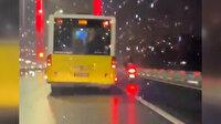 İETT şoförü fırtınada köprüden geçemeyen motosikletliye kalkan oldu
