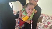 Boğazına meyve kaçan Aysima bebek telefonda anlatılan teknikle kurtarıldı