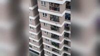 Binanın 12'nci katından düşen küçük kızı kurye kurtardı