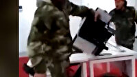 Darbeci Hafter'e bağlı milislerin otomotiv şirketini yağmaladığı anla kamerada